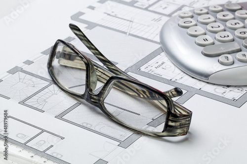 glasses on the desk of an Architect