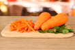 carrots on cutting board on table in kitchen