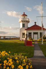 Beautiful Washington lighthouse with daffodils in spring