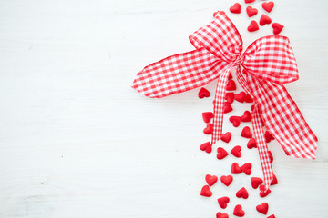 White wooden background with little hearts