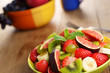 Healthy fruit mix salad on the kitchen table