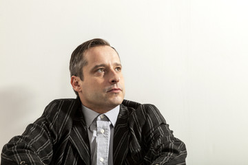 portrait of adult man,. wall white background
