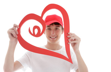 Teen looking through a red love heart