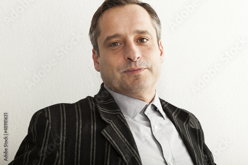 portrait of adult man, wall white background