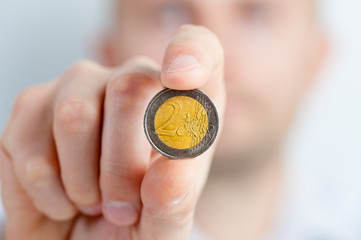 a man with a coin