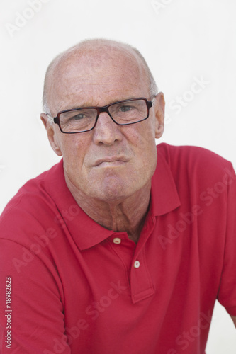 anxious retired man with red shirt