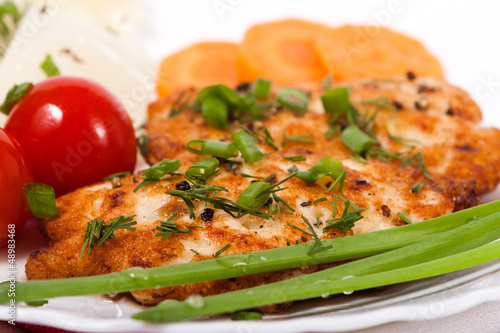 Chicken chopped meat cutlet with vegetables and greens