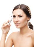 Woman with eyelash curler, isolated over white