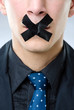 Man with black tape over his mouth