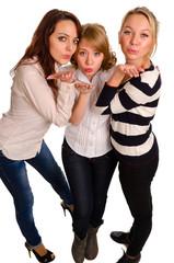 Three sexy girls blowing a kiss