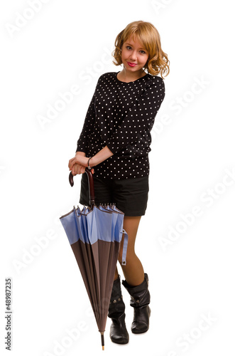 Smiling trendy young woman with an umbrella