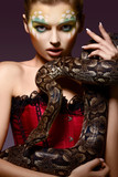 Serpent. Fantasy. Fancy Woman holding Tamed Snake in Hands poster