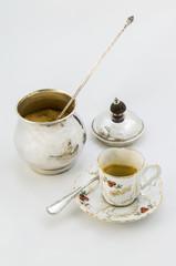Taza de café y azucarero