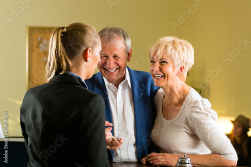 Reception - Guests check in a hotel
