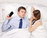 woman and businessman in bed