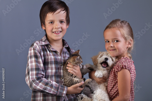 Beautiful kids with their lovely pets