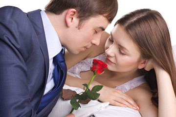 man present a rose to girl
