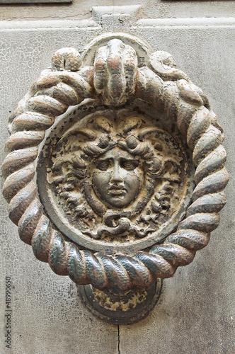 Doorknocker. Piacenza. Emilia-Romagna. Italy.