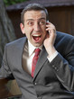 excited businessman on the phone outdoors