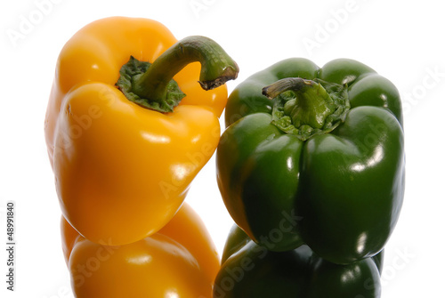 green and yellow sweet pepper on a white background