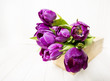 purple tulips on a  white wooden table