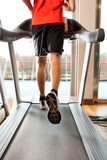 Man training on treadmills
