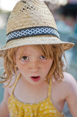 Expressive girl with a hat