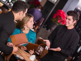 Waiter explaining the menu