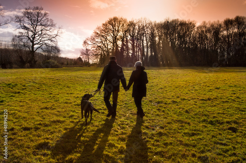 canvas print picture couple with dog sunset