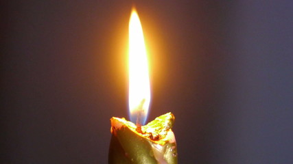 Flame of candle. Close-up shot.