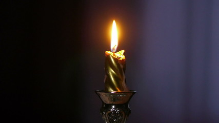 Candle burning on a candlestick