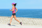 Female athlete running on vacation