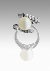 Ring with pearl and diamonds on grey