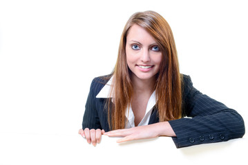 Young businesswoman holding blank message board