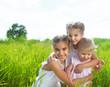 Smiling happy little girls on meadow