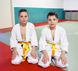 boys in sports hall is engaged in judo