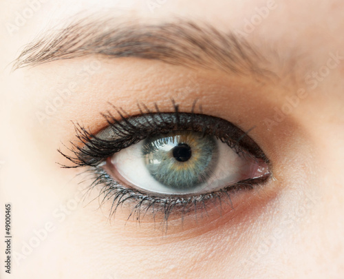 Beautiful blue woman eye close up