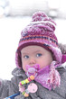 portrait of a one year old girl during winter