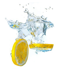 Lemon slices and ice cubes splashing water, isolated on white