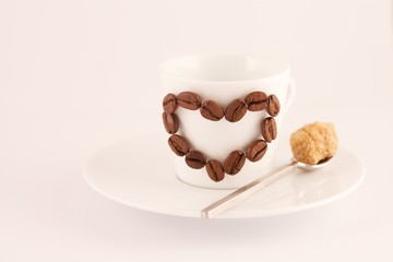 Coffee heart on a cup and spoon.