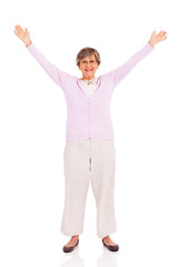 senior woman arms up isolated on white background