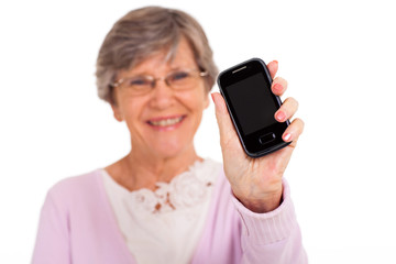 senior woman showing message on cell phone