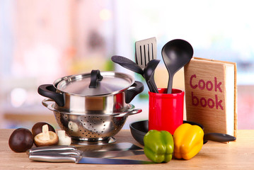 composition of kitchen tools and vegetables on table in kitchen