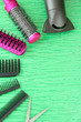 Comb brushes, hairdryer and cutting shears,on color background