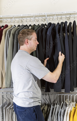 Mature man deciding what clothing to wear