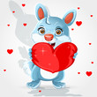 Cute little bunny holds a soft red heart-pillow Valentine gift