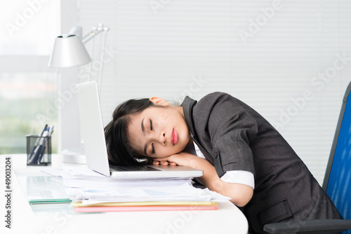 Tired Asian businesswoman