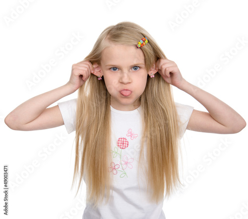 girl pulling faces. isolated on white