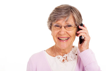 happy senior woman talking on cell phone isolated on white