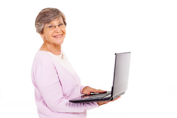 elderly woman with laptop computer isolated on white
